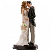 Nevěsta a ženich při novomanželském polibku - svatební figurky